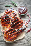 Grilled pork ribs on the wooden background Stock Photography