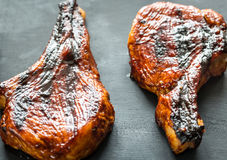 Grilled pork ribs on the wooden background Royalty Free Stock Photography