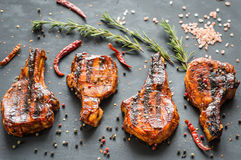 Grilled pork ribs on the wooden background Stock Photos