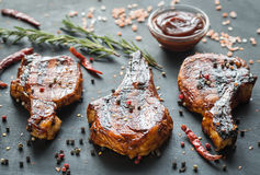 Grilled pork ribs on the wooden background Stock Images