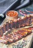 Grilled pork ribs. On the wooden board Stock Images