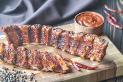 Grilled pork ribs. On the wooden board Royalty Free Stock Image