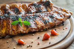 Grilled pork ribs  on the wooden board Royalty Free Stock Image
