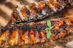 Grilled pork ribs on the wooden board Stock Images