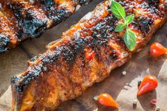 Grilled pork ribs on the wooden board Stock Photography