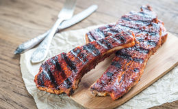 Grilled pork ribs on the wooden board Stock Image