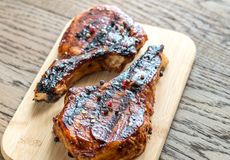 Grilled pork ribs on the wooden board Royalty Free Stock Images