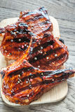 Grilled pork ribs on the wooden board Stock Photos