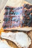 Grilled pork ribs on the wooden board. Top view Stock Images
