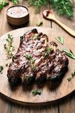 Grilled pork ribs. On wooden board, shallow depth of field Royalty Free Stock Photography