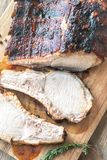 Grilled pork ribs on the wooden board. Top view Royalty Free Stock Photography