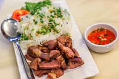 Grilled pork with rice noodle in the white place with chilli dipping sauce Royalty Free Stock Image
