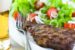 Grilled pork with salad and beer Stock Images
