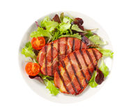 Grilled pork with salad greens Royalty Free Stock Photography