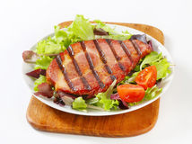 Grilled pork with salad greens Royalty Free Stock Image