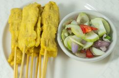 Grilled Pork Satay with Cucumber Salad on White Plate Royalty Free Stock Photo