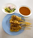 Grilled Pork Satay with Peanut Sauce and Vinegar. Asian food - Grilled Pork Satay and side dishes Vinegar with Peanut Sauce Stock Photo