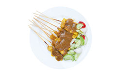 Grilled Pork Satay with Peanut Sauce and Vinegar on white dish isolated on white Stock Photo