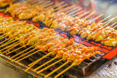 Grilled pork satays on the stove oven. Thai style Royalty Free Stock Image