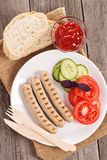 Grilled pork sausages on a plate Stock Photos