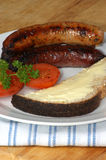 Grilled pork sausages, tomato and toast bread Stock Images