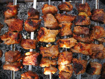 Grilled pork. Pork shish kebab prepared on coals Stock Images