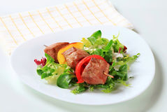 Grilled pork skewer with salad greens Stock Photos
