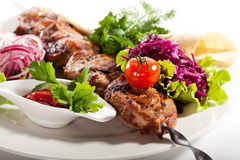Grilled Pork. Skewered Pork with Vegetables and Onions Stock Images