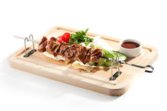 Grilled Pork Skeweres. With Vegetables and Sauce Royalty Free Stock Image
