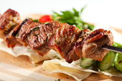 Grilled Pork Skeweres. With Vegetables and Sauce Royalty Free Stock Images