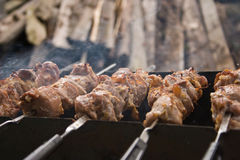 Grilled pork on the skewers. Pieces of pork grilled on skewers closeup stock photography