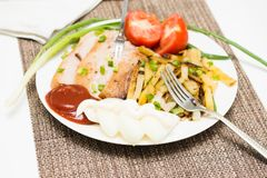 Grilled pork slices with garnish and vegetables Royalty Free Stock Images