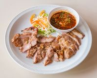 Grilled pork with dip sauce Stock Images