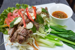 Grilled pork. With spicy seafood sauce Royalty Free Stock Photos