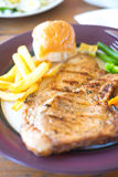 Grilled pork steak with black pepper,French Fries Royalty Free Stock Image