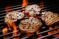 Grilled pork steak. On the flaming grill Stock Photography