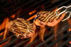 Grilled pork steak. On the flaming grill Stock Images