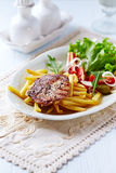 Grilled Pork Steak with French Fries Stock Photos