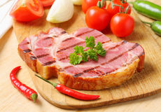 Grilled pork steak and fresh vegetables Stock Images