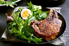 Grilled pork steak with green salad Royalty Free Stock Image