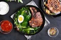 Grilled pork steak with green salad Stock Photos