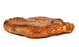 Grilled pork steak. Marinated in beer and spices on white background Stock Image