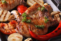 Grilled pork steak with mushrooms and peppers top view macro Stock Images