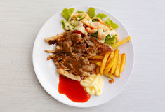 Grilled pork steak with potato and salad Royalty Free Stock Photos