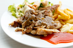 Grilled pork steak with potato and salad Royalty Free Stock Photo