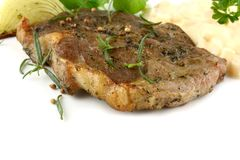 Grilled pork steak with potato salad and herbs Stock Image