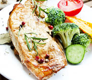 Grilled Pork Steak with Rosemary and Vegetables Royalty Free Stock Images