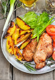Grilled pork steak on rustic table Stock Photo