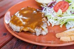 Grilled pork steak with salad Stock Photo