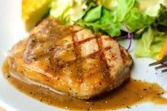 Grilled pork steak and vegetables Stock Image